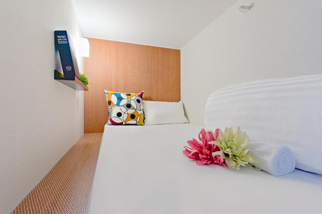 A bed or beds in a room at Hostel Yu - Luxury Mixed Dormitory -