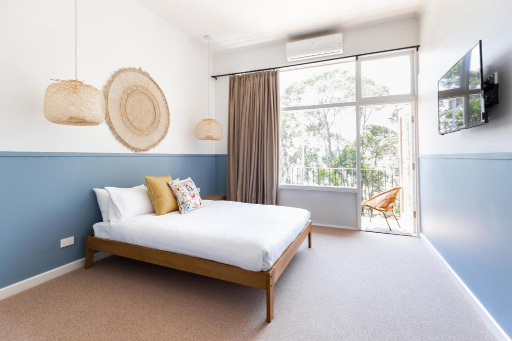 A bed or beds in a room at Lorne Hotel