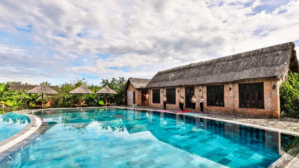 The swimming pool at or close to Hue Ecolodge