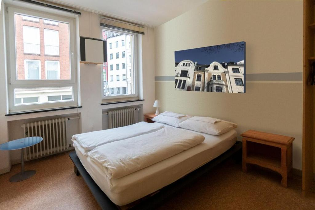 A bed or beds in a room at Hostel Aachen