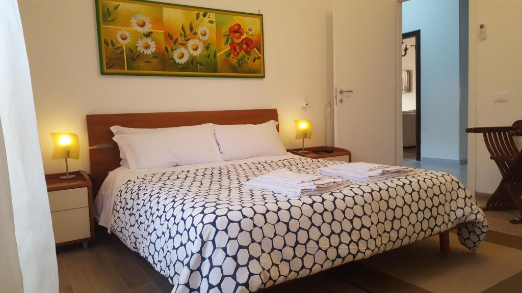A bed or beds in a room at Casa Relax Fam. D'Amata