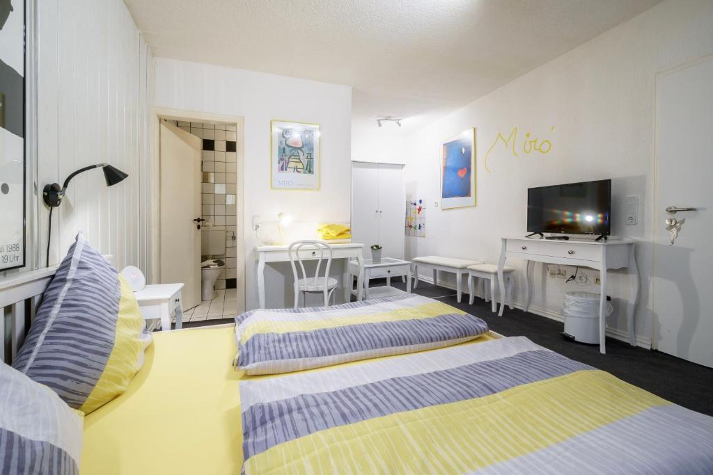 Ein Bett oder Betten in einem Zimmer der Unterkunft Hotel Tusculum