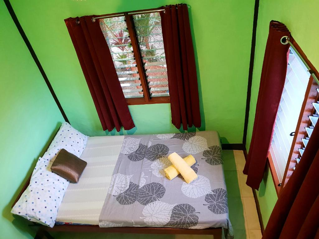 A bed or beds in a room at Charity homestay