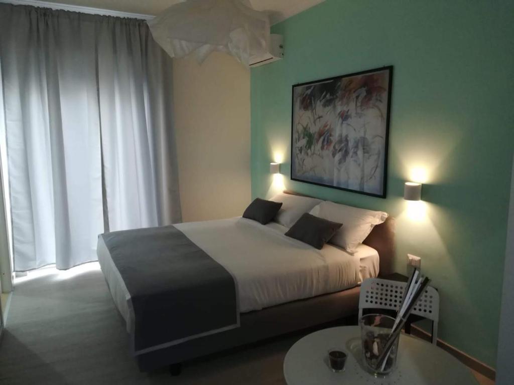 Letto o letti in una camera di F.Rooms Napoli