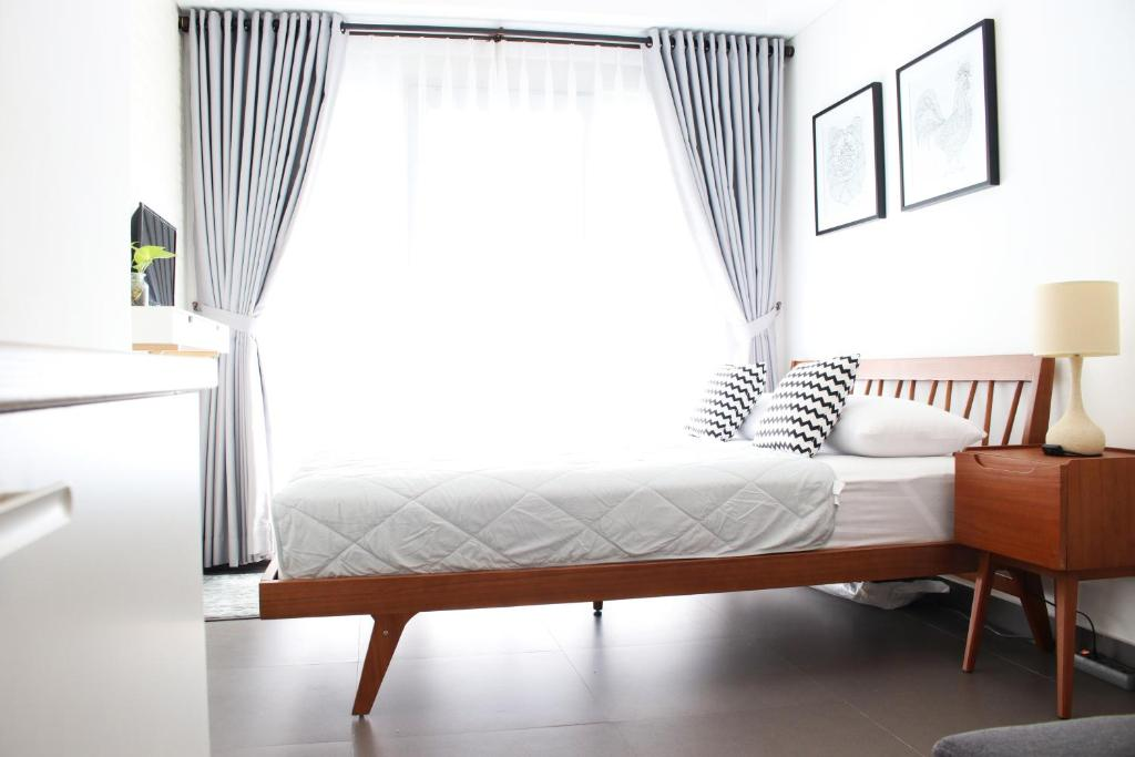 A bed or beds in a room at Scandinavian Asia Afrika
