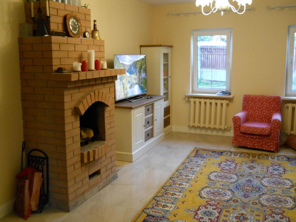 A kitchen or kitchenette at House with a fireplace on the river