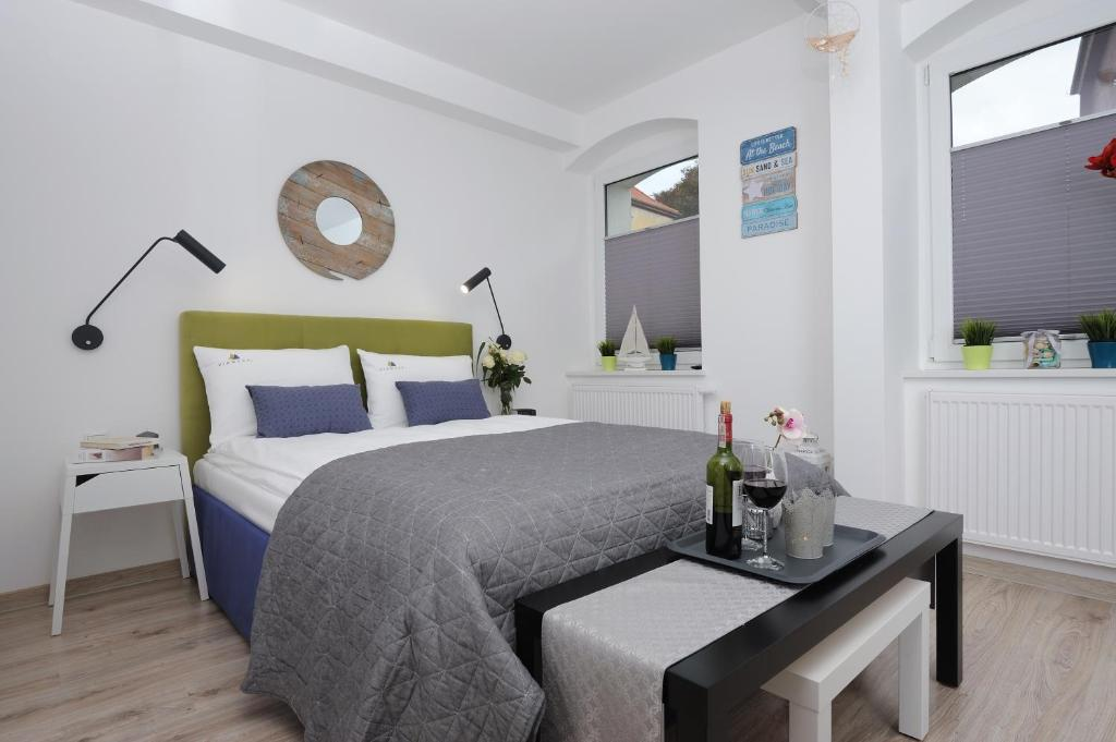 Łóżko lub łóżka w pokoju w obiekcie Apartamenty Via Mare