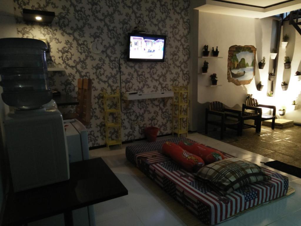 A seating area at Vila Oma Sukari Syariah Home Living