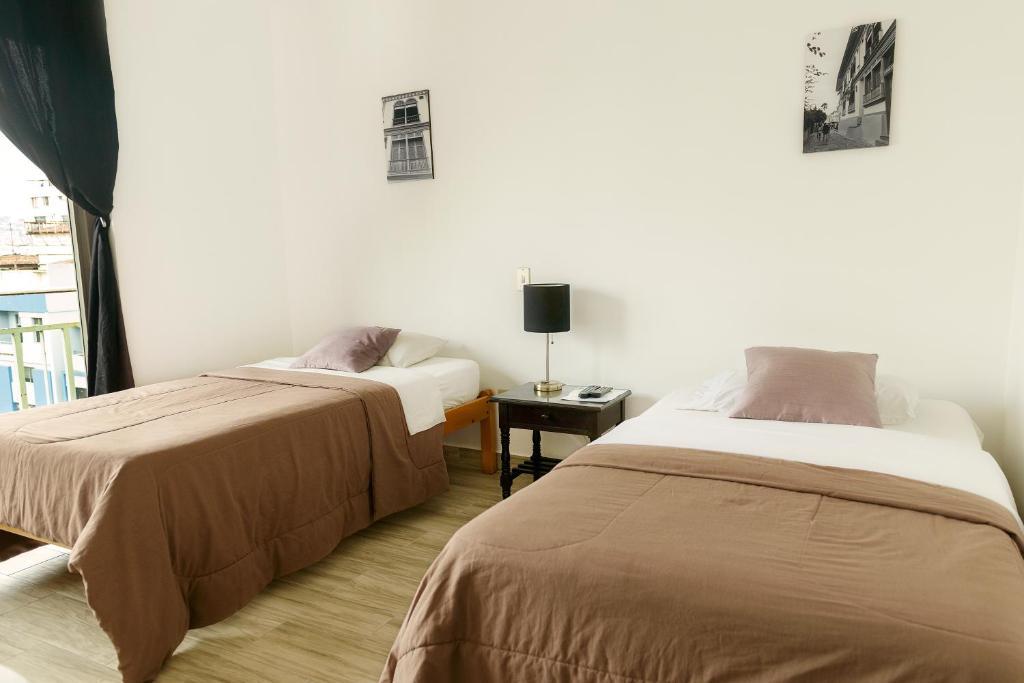 A bed or beds in a room at Casa De Romero