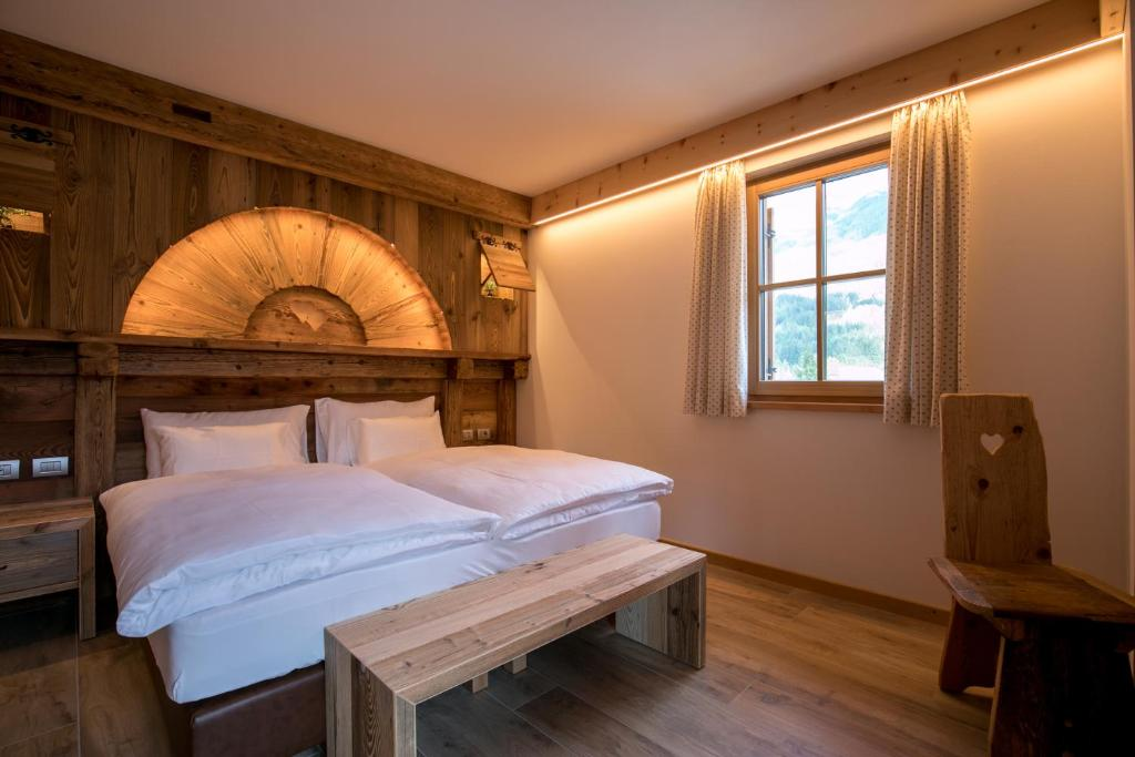 A bed or beds in a room at Agriturismo Malga Piè