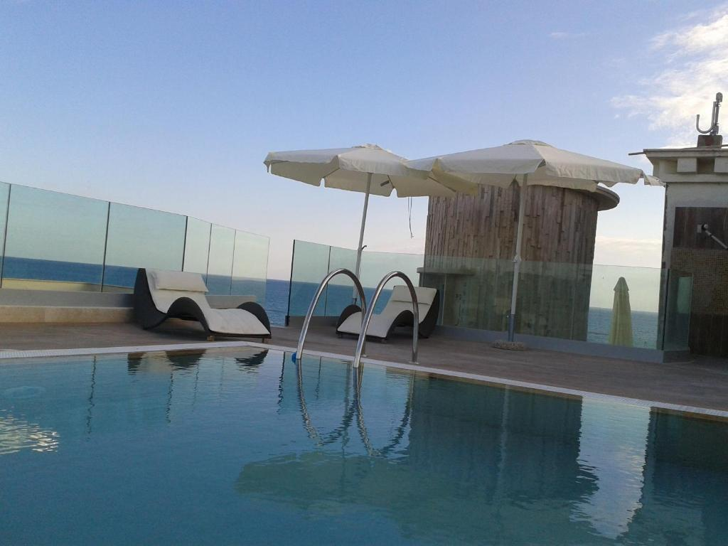The swimming pool at or near Hotel L'Approdo