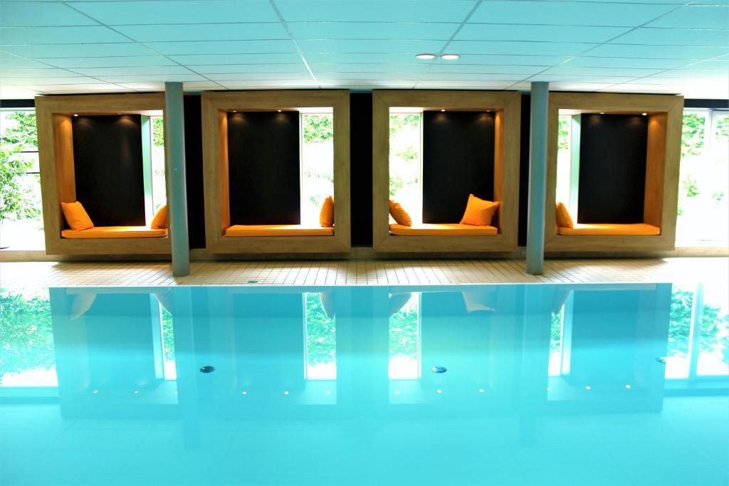 Der Swimmingpool an oder in der Nähe von Appartementhaus Regina