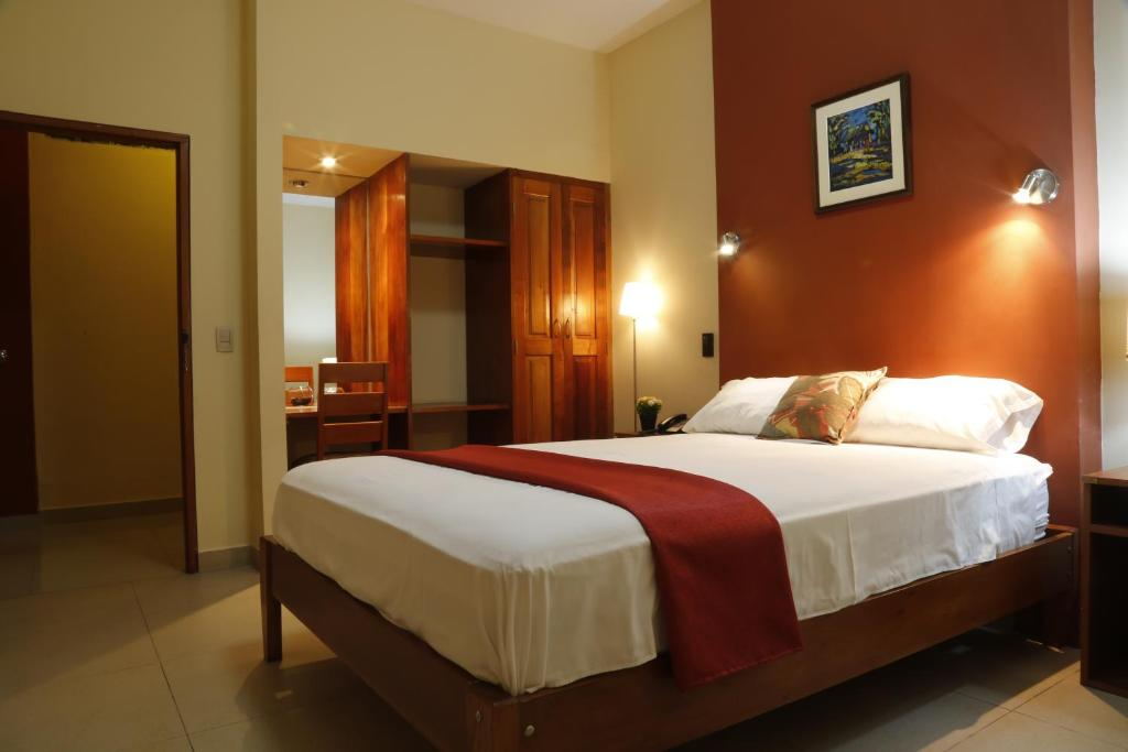 A bed or beds in a room at Palau Amazonas Hotel