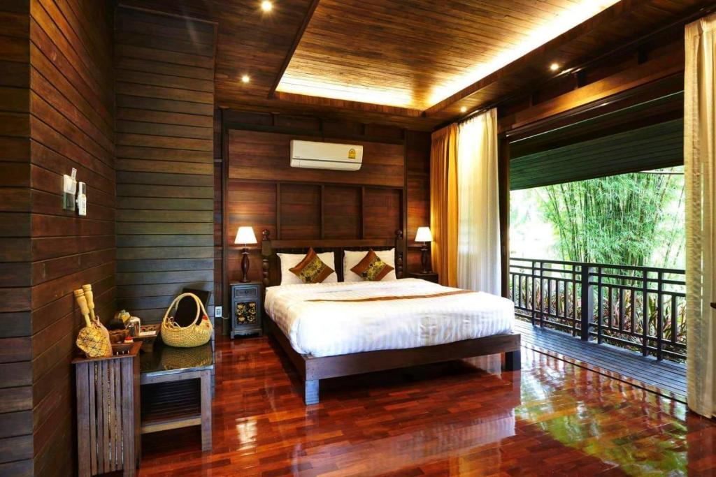 Un ou plusieurs lits dans un hébergement de l'établissement คุ้มสะเมิง-Samoeng Center