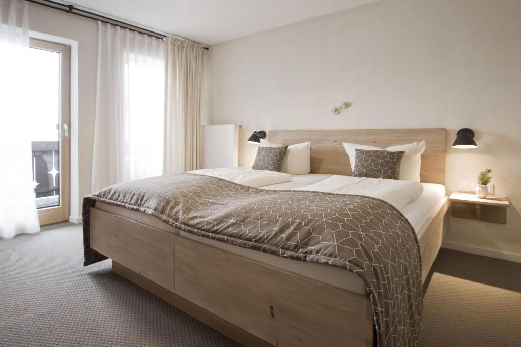 Ein Bett oder Betten in einem Zimmer der Unterkunft Bavaria Biohotel