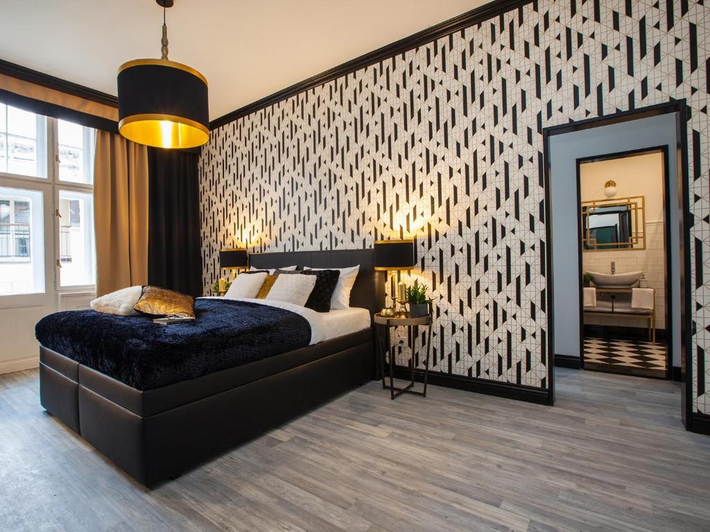 Letto o letti in una camera di Golden Prague Rooms
