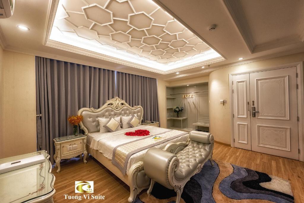Giường trong phòng chung tại Tuong Vi Hotel Saigon