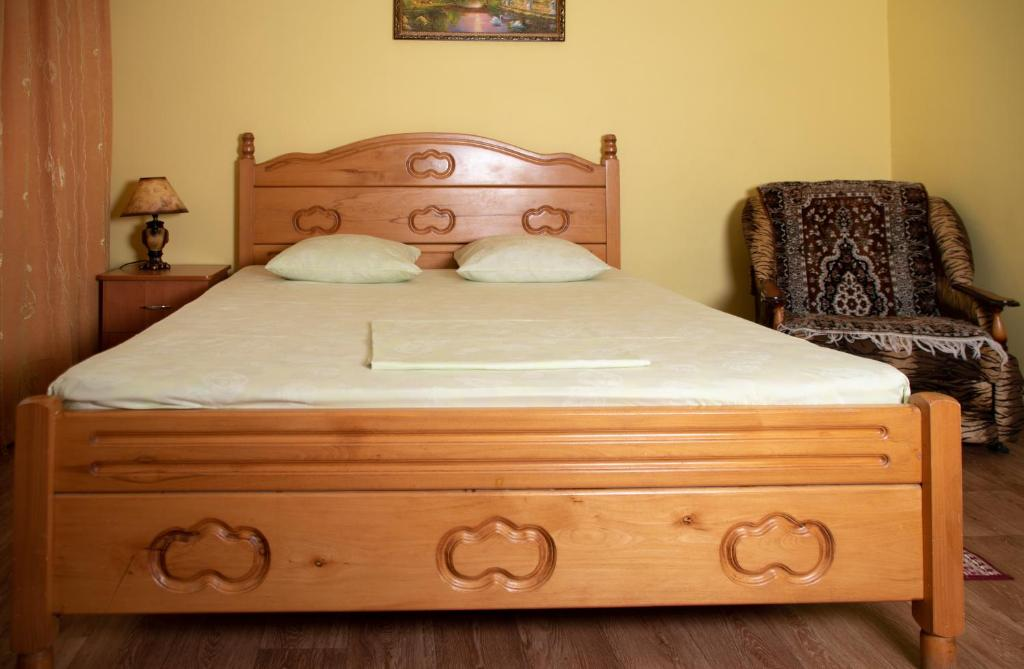 A bed or beds in a room at Guest house Chetyre podkovy
