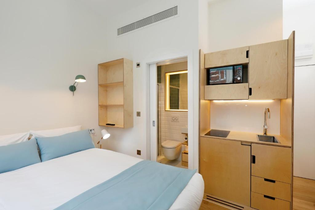 A room with a kitchenette at the Exhibition Court Hotel.