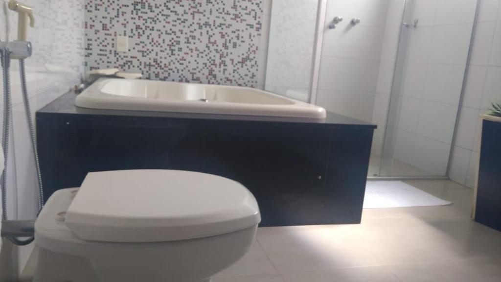 Um banheiro em Dallas Hotel