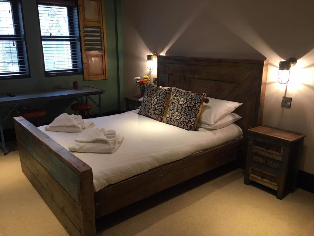 A bed or beds in a room at Charter House