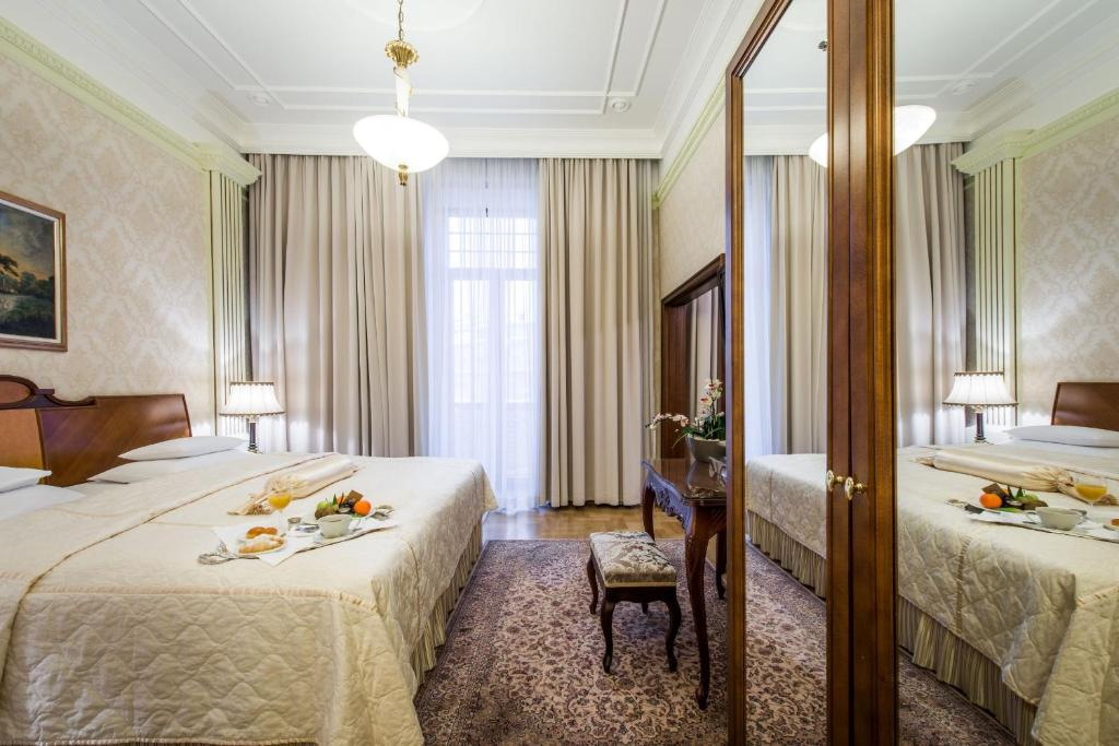 A bed or beds in a room at Hotel Moskva