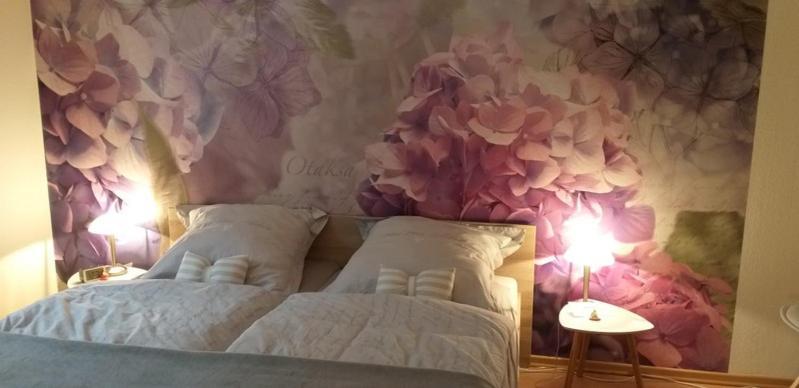 A bed or beds in a room at Wohnung im Dreistädteeck