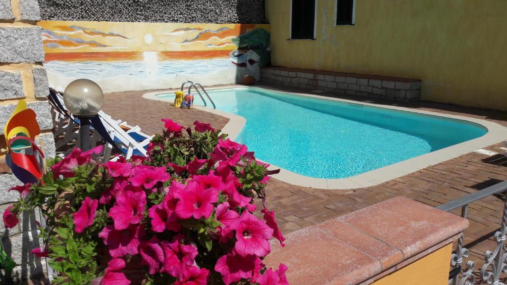 The swimming pool at or near Borgo Marino Badesi