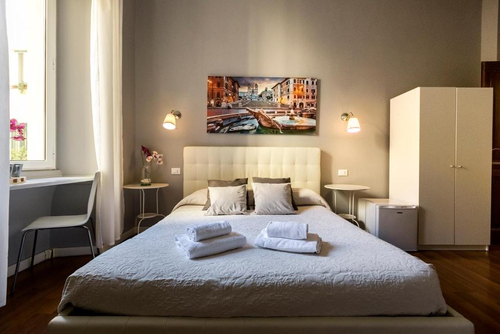 A bed or beds in a room at Dulcis In Fundo