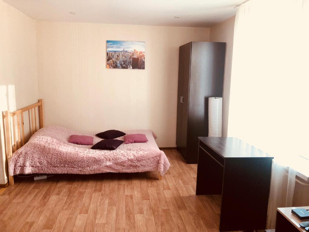 Кровать или кровати в номере Studio on Lobachevskogo street