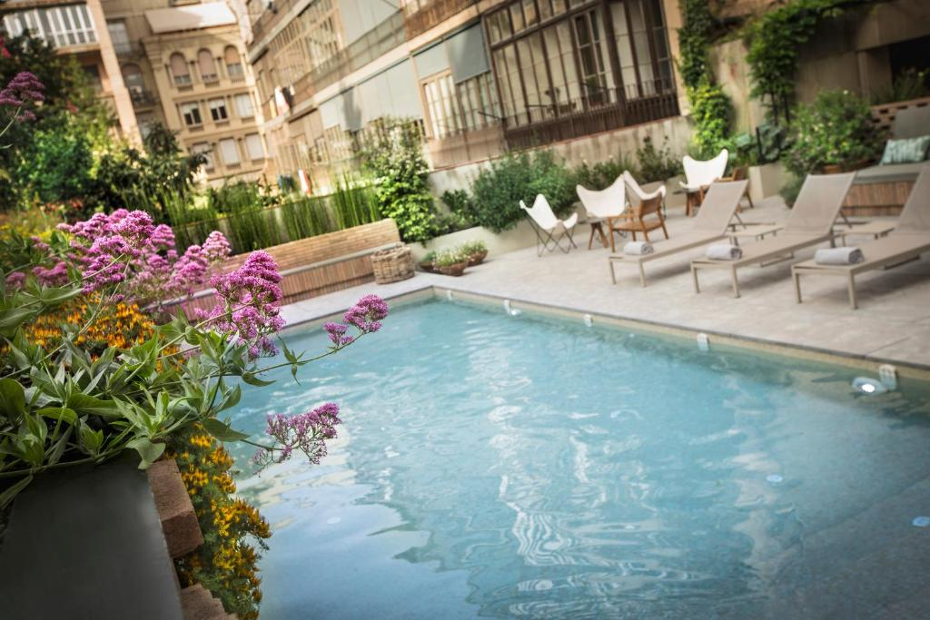 The swimming pool at or near Alexandra Barcelona Hotel, Curio Collection by Hilton