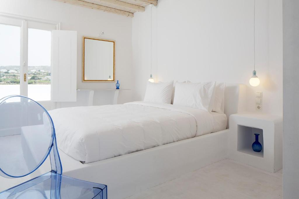 A bed or beds in a room at Aether Boutique Stay