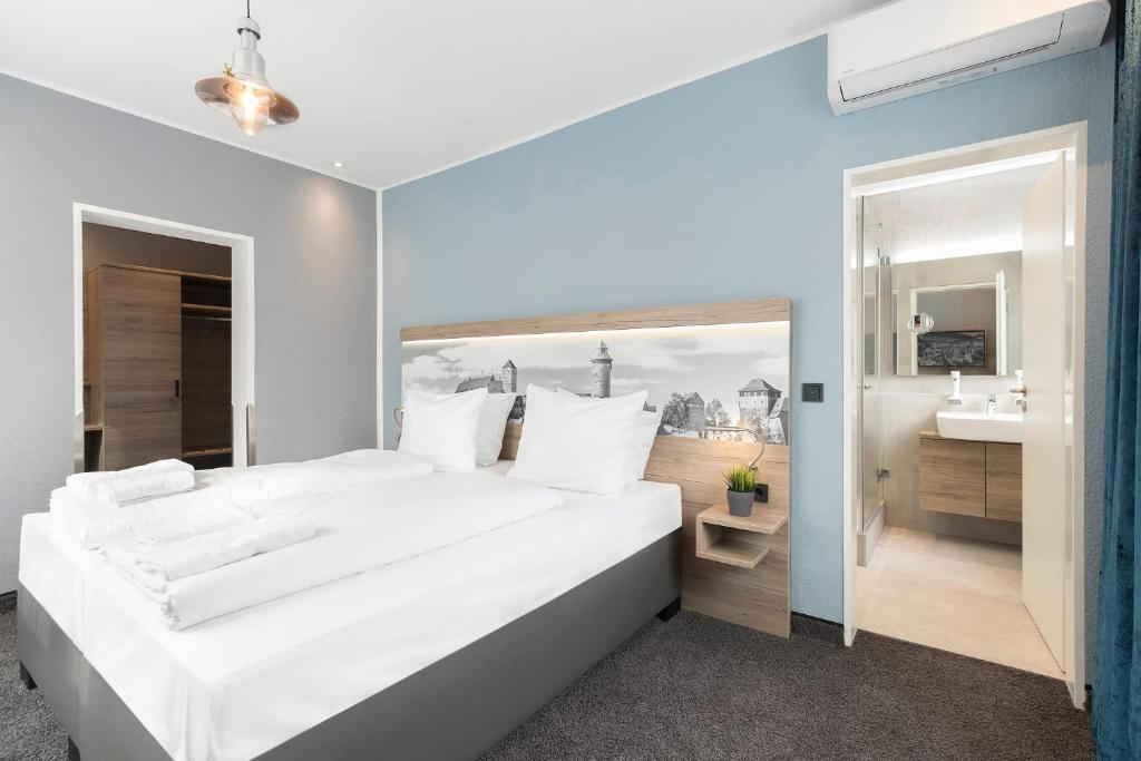 A bed or beds in a room at Hotel dasPaul