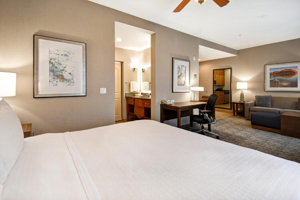 A bed or beds in a room at Homewood Suites by Hilton Boise