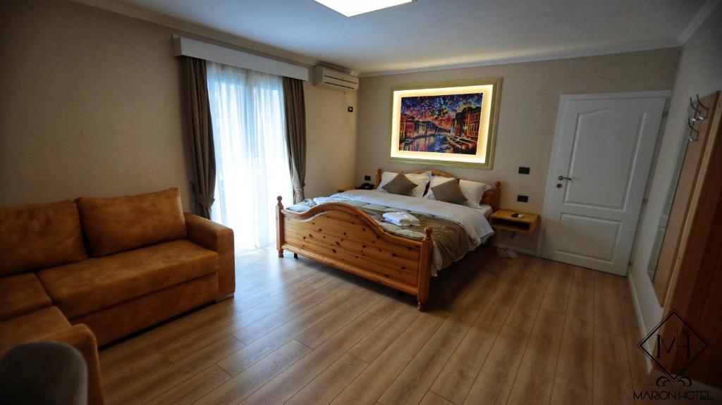 Cama o camas de una habitación en MARION HOTEL