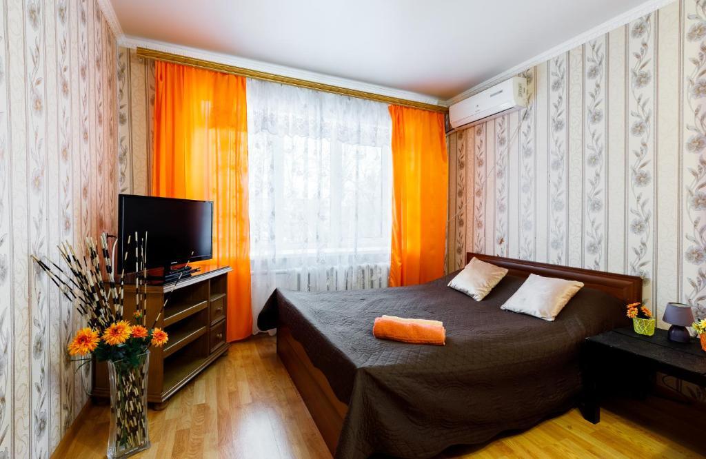 Кровать или кровати в номере Квартира в самом центре Тулы