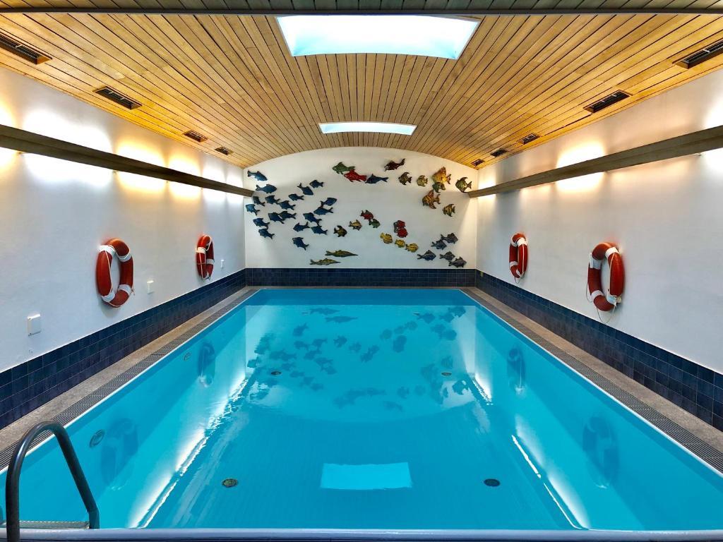 The swimming pool at or near Hotel Vier Jahreszeiten