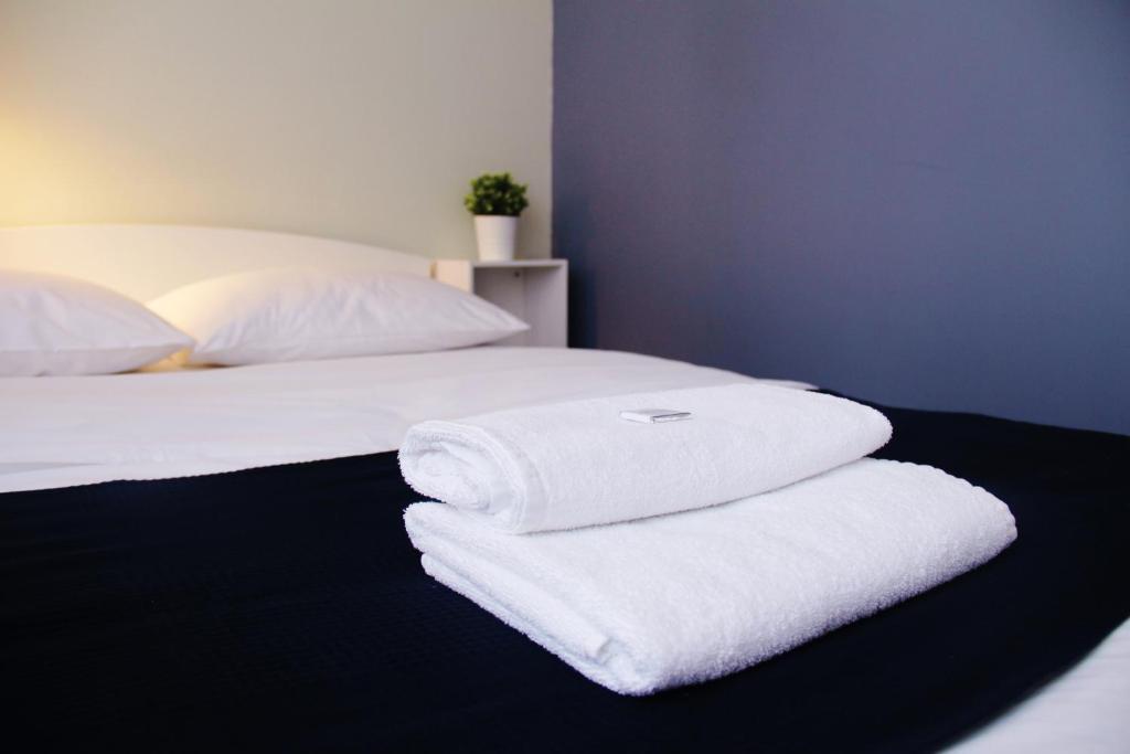 Кровать или кровати в номере Отель Арт Инн