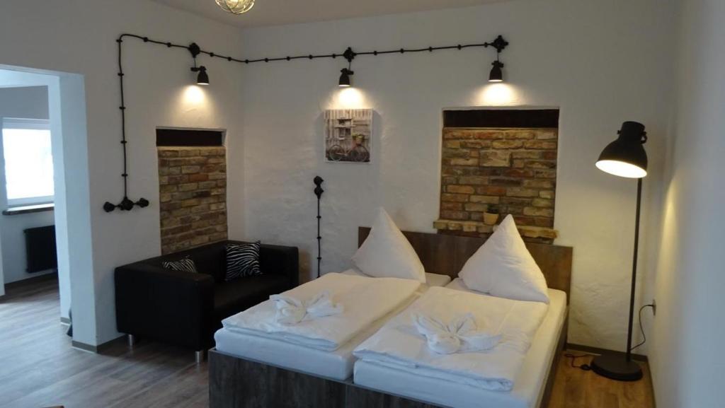 Ein Bett oder Betten in einem Zimmer der Unterkunft Gästehaus Strausberg