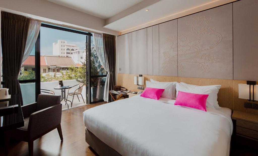 Cama o camas de una habitación en Victoria Garden Hotel