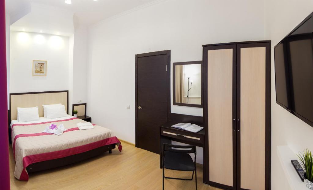 Кровать или кровати в номере Минима Динамо