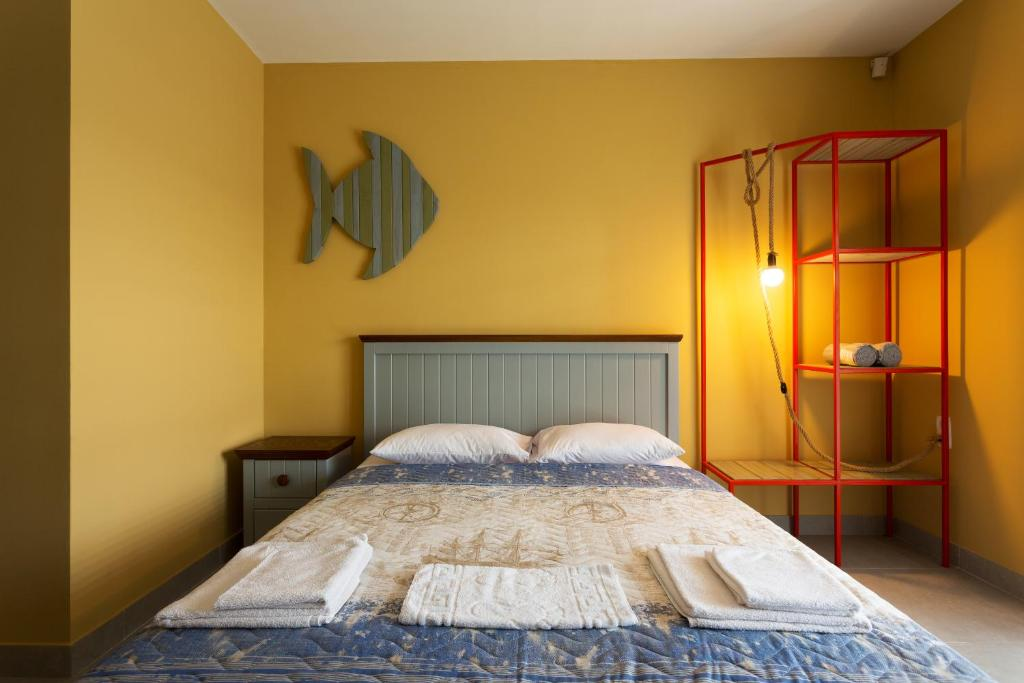 Кровать или кровати в номере Комплекс Маяк с собственным пляжиком