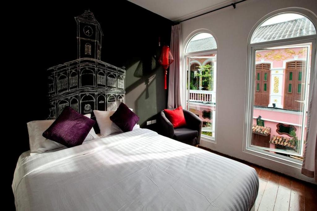 A bed or beds in a room at The Rommanee Boutique Guesthouse