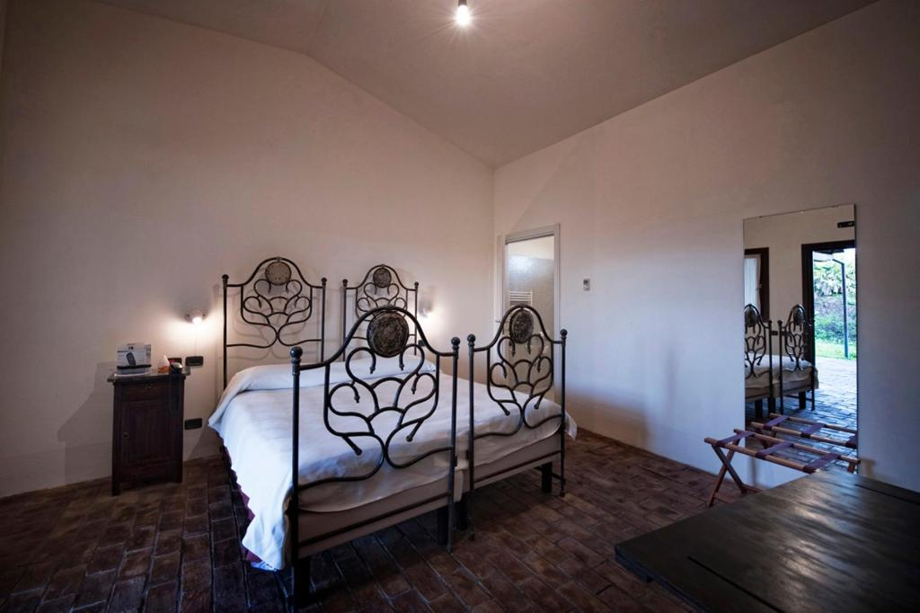 A bed or beds in a room at Foro Appio Mansio Hotel