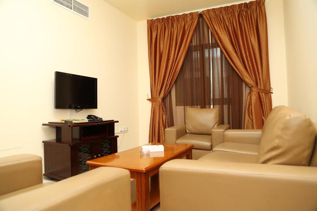 A seating area at Safari Hotel Apartments - Tabasum Group