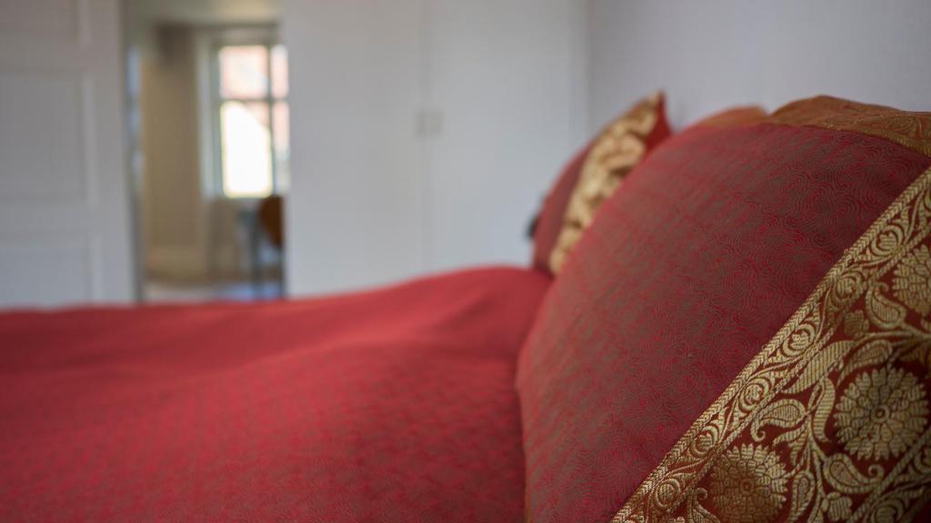 En eller flere senge i et værelse på Svaneke Havkig