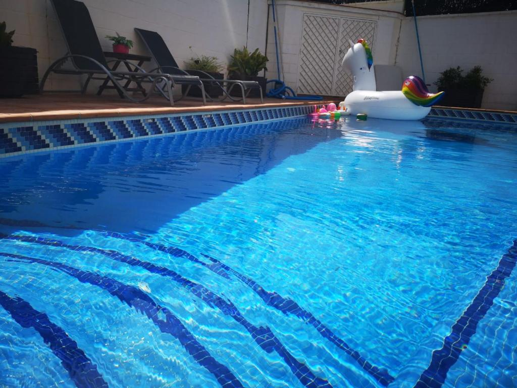 The swimming pool at or near Luxury semidetached house
