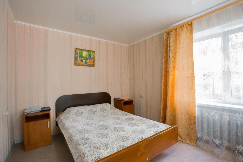 Кровать или кровати в номере Квартира на Мира, 14-36