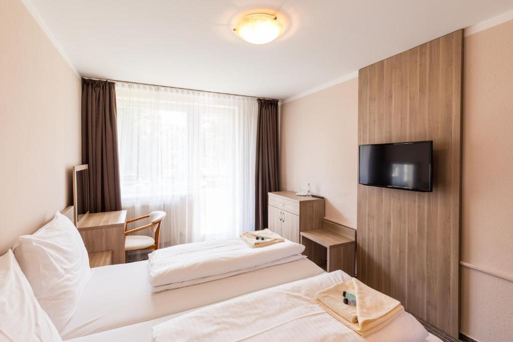 Televízia a/alebo spoločenská miestnosť v ubytovaní Bed & Breakfast Hotel Perla