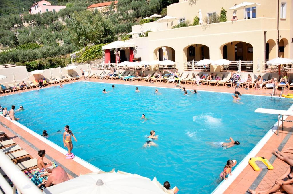 The swimming pool at or near Il Villaggio Di Giuele
